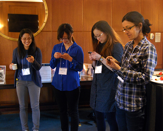 Barbour Scholar alumnae admire their new pins.