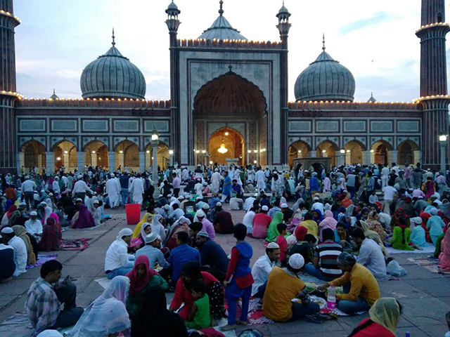 People gathered at Roza in Delhi, India.