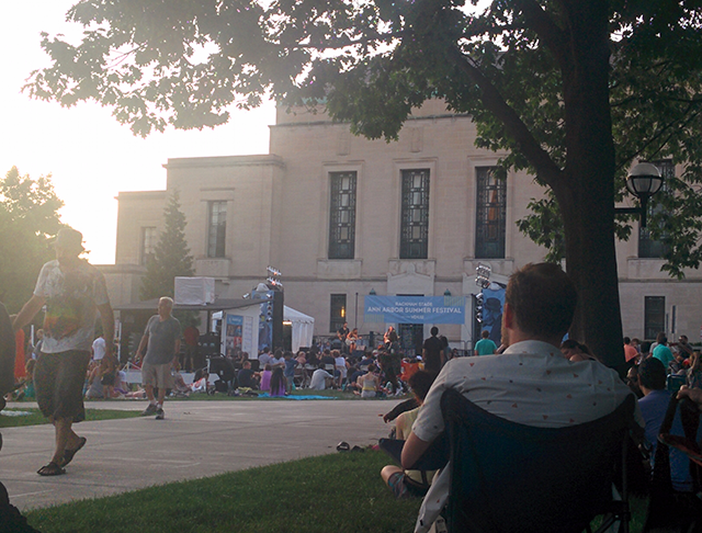 The sun sets as the band The Crane Wives plays on Central Campus as part of the Ann Arbor Summer Festival.