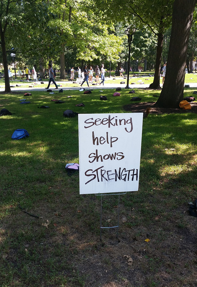 Hand written sign on the Diag which says 'Seeking help shows STRENGTH.'