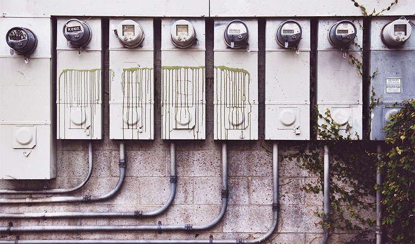 concrete wall with electric meters